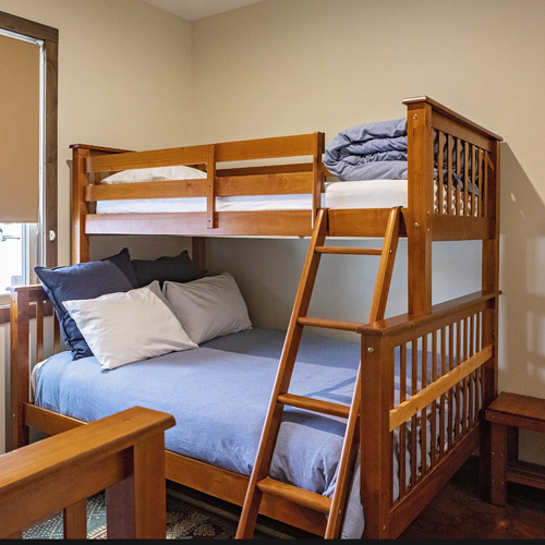 Two bunk beds with a bottom double mattress and twin top mattress.