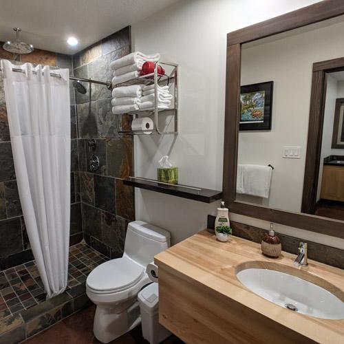 Shower in style; slate shower with rain heads. Shared washroom.