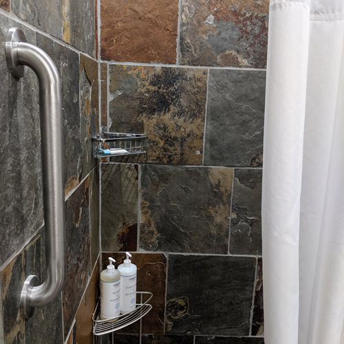 Our showers are fully accessible, with grab bars in each shower.